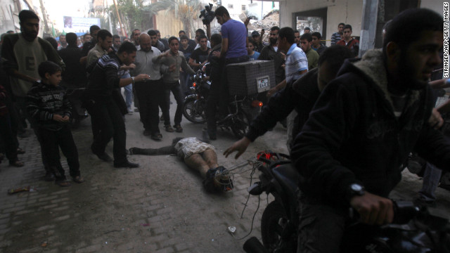 November 20: Men on motorcycles drag the body of a man through the streets of Gaza City. The men dragging the body claimed it was the body of a collaborator and an Israeli spy. Hamas and Israel agreed to a cease-fire on November 21 after eight days of round-the-clock warfare.