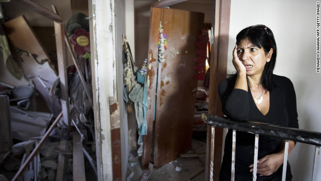 Ronit Hakmon reacts to the damage to her home in Beer Sheva, Israel, on Tuesday, after a rocket from Gaza militants hit it.
