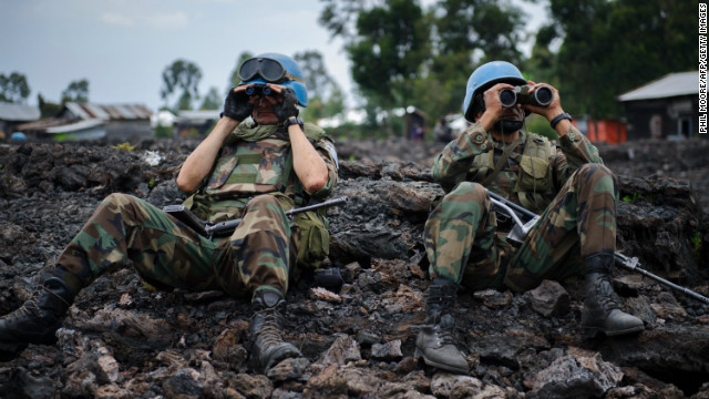 Uruguayan United Nations peacekeepers look through binoculars at M23 rebel positions on the outskirts of Goma.