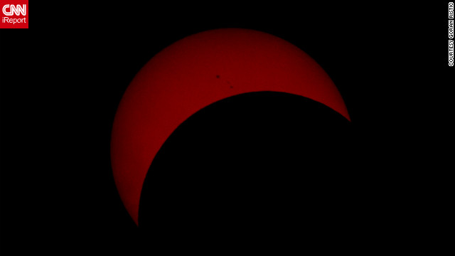 """The photograph I uploaded is approximately 17-18 minutes past the peak of the eclipse. The reason I chose that photo is because it shows a few Sun spots, and it's not just a solid block of reddish colour like those I took closer to the peak,"" says <a href='http://ireport.cnn.com/docs/DOC-882137' target='_blank'>Goran Ristic</a> from Auckland, New Zealand."