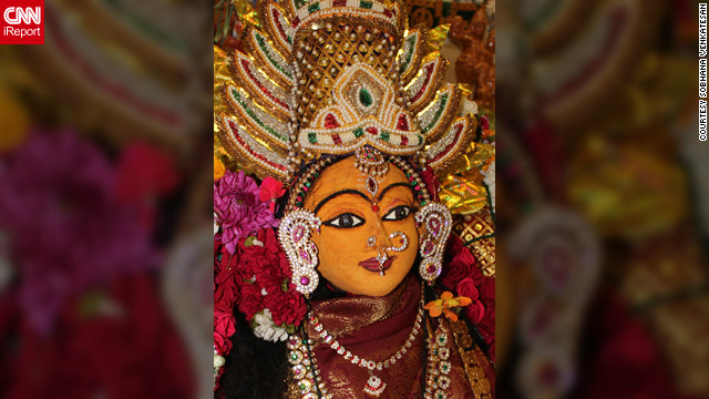 "<a href='http://ireport.cnn.com/docs/DOC-883257' target='_blank'>Sobhana Venkatesan</a> lives in St. John's, Newfoundland, Canada. The photo depicts an ""Amman Alankaram "" of Goddess Lakshmi. It was made by covering sandalwood paste on a dehusked coconut shell before Lakshmi's facial features were painted in. ""Prayers offered to Goddess of Wealth, Lakshmi, during Diwali celebrations beckons prosperity into our homes and lives,"" says the 52-year-old."