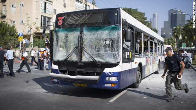 Emergency services personnel work at the scene of an explosion on a bus Wednesday in Tel Aviv, Is