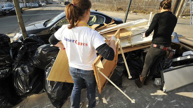 AmeriCares volunteers help clean out flood-damaged homes in Queens, New York, during