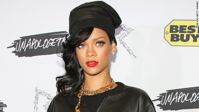 Rihanna, with a new No. 1, says sorry to plane press