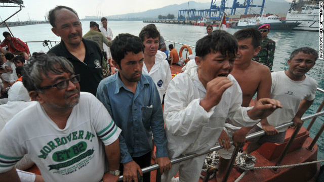 Asylum seekers are pictured on August 31 after they were rescued when their boat sank en route to Australia.