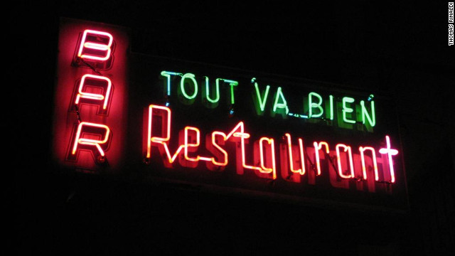 Tout Va Bien Restaurant on West 51st St. in Manhattan is marked with a circa 1955 Midtown Neon Sign Corp. creation.