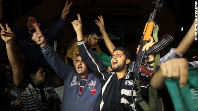 Palestinians celebrate news of the cease-fire with Israel in Gaza City on Wednesday,