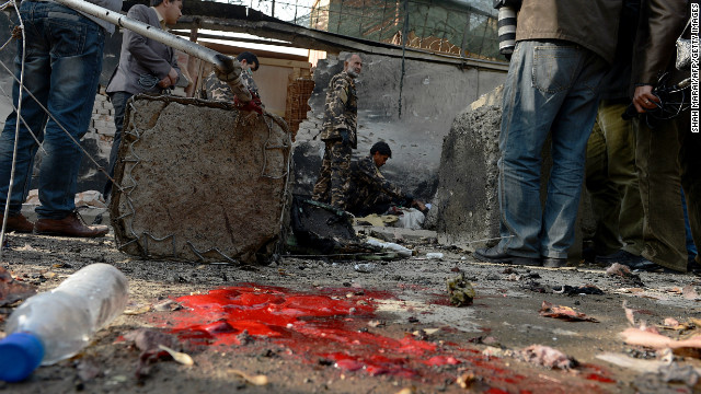Afghan security forces inspect the site of a suicide attack in Kabul on Wednesday.
