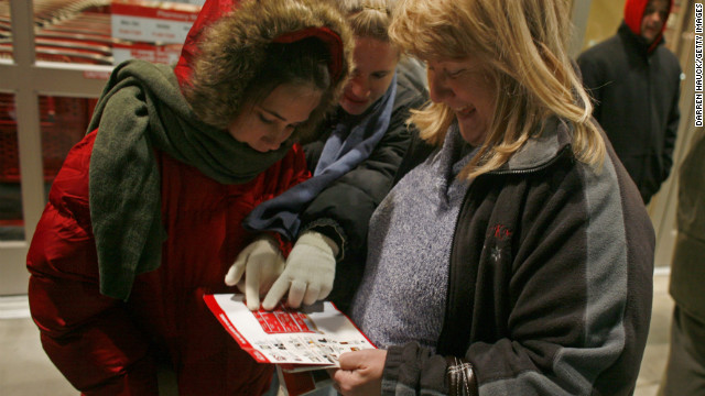 Jean Menarek, right, and her daughters Kayla and Deanna brave the cold Pleasant Prarie, Wisconsin temperatures on November 28, 2008 as they go over Target's Black Friday deals.