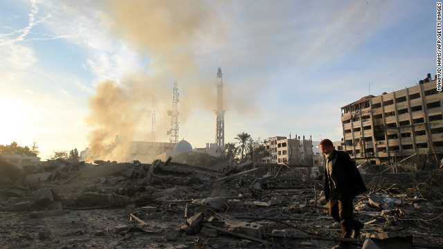 A Palestinian man walks amidst debris at the destroyed compound of the the internal security ministry in Gaza