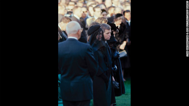 John F. Kennedy's widow, Jacqueline Kennedy, and brother Robert Kennedy attend his funeral at Arlington National Cemetery. See the complete gallery of photos at LIFE.com.