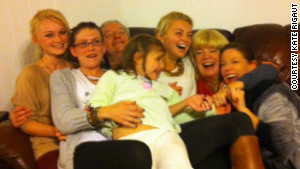 Family and friends pile on the couch at the so-called \'Douglas Family Compound.\'