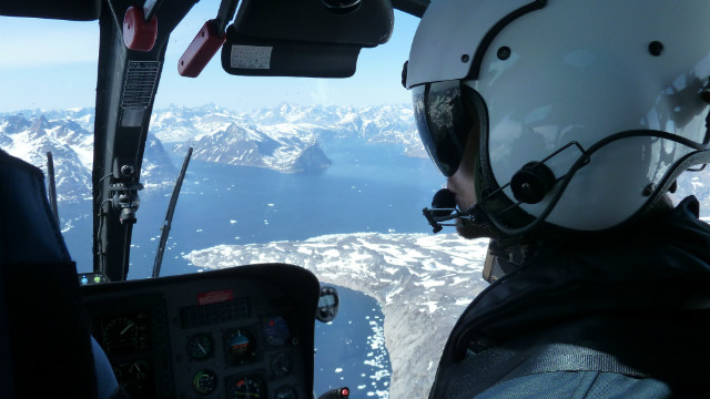Pilot Karsten Andsbjerg flying the helicopter. Flying here is extremely difficult because of gusty winds and rapidly changing weather.