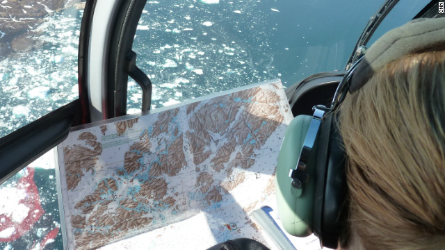 Ice observer Jane Robertsen with a map of southern Greenland. The Ice Patrol flies missions here three times a week if the weather permits to keep ships up to date on the movement of the icebergs.