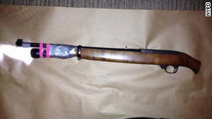 A sawed-off .22-caliber rifle was found among the belongings of Salvatore Perrone, held in the deaths of three merchants.