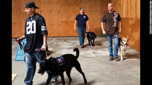 """Sometimes these vets need the help and care of a friend,"" photographer Benjamin Lowy said. ""These service animals ... can help them get through their day."""
