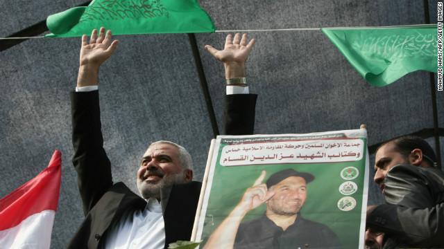 Hamas Prime Minister Ismail Haniyeh waves to the crowd Thursday in Gaza City. Haniyeh, who heads the governing party of Gaza, said the cease-fire showed the United States had been forced to soften its stance in the region in the wake of the Arab Spring.