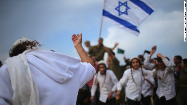 Hasidic Jewish boys dance near the border with northern Gaza on Thursday. The Jews provided music on a visit to show their support for the Israeli soldiers.