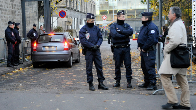 Policemen guard a Bordeaux courthouse where former French president Nicolas Sarkozy is due to appear.