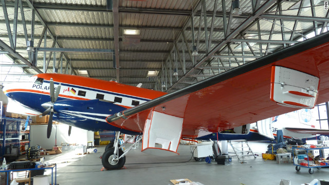 Research Aircraft POLAR 6 being outfitted with scientific antennas and computers at the Alfred-Wegener-Institutes hangar in Bremerhaven, Germany. The plane is a totally rebuilt DC-3 Dakota from World War II.