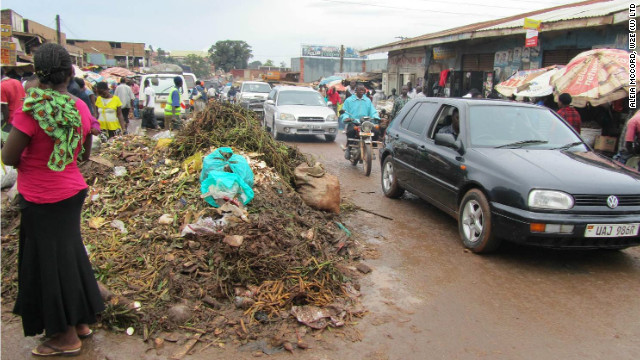 Uncollected waste lies in the streets of an urban slum in Uganda, which can cause flooding and breeding sites for waterborne diseases.