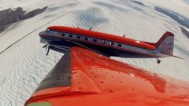 POLAR 6 banking over a glacier near Kangerlussuaq in Greenland en route to a radar survey flight over Greenland's inland ice.