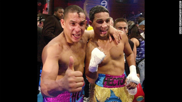Camacho and his son, undefeated super lightweight champion Hector &quot;Macho&quot; Camacho Jr., celebrate their wins in Miami on February 3, 2001. They were the first father and son tandem to share the same boxing card since 1975.