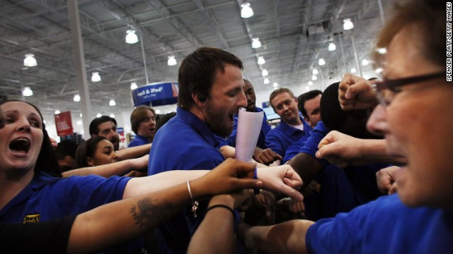 Best Buy employees have a group huddle before they open the store in Naples, Florida.