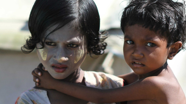 A girl wearing &quot;thanaka&quot; on her face carries her brother. The traditional cosmetic made form tree bark is used as sunscreen, insect repellent and antiseptic. After nearly half a year in the camps doctors are afraid more an more children are at risk of acute malnutrition.