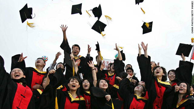 Students celebrate during their graduation ceremony at Shanghai Jiaotong University in June 2005.
