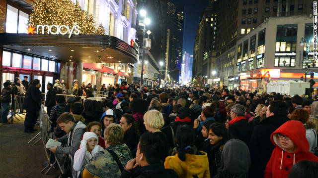 Crowds gather outside Macy's department store on Thanksgiving Day in New York in advance of the midnight opening.