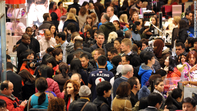 Shoppers crowd a Macy's in New York for the store's Black Friday sale on November 23, 2012. Some stores opened even earlier, cutting into the Thanksgiving celebrations and indicating that even this cherished American family holiday is falling prey to the forces of commerce.