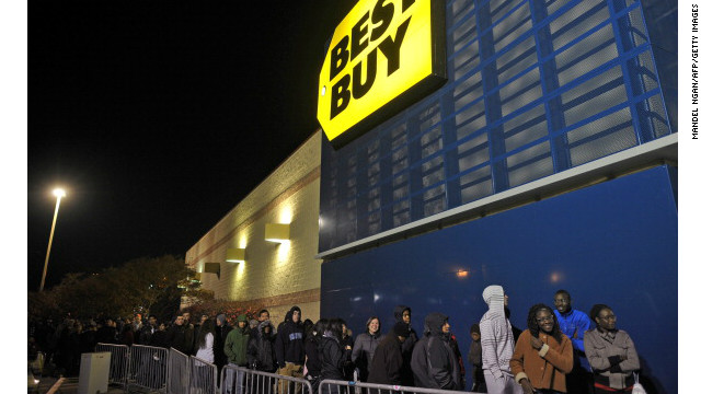 Shoppers queue outside of a Best Buy store during its Black Friday sale, which started at midnight on Friday in Rockville, Maryland.