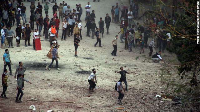 Egyptian protesters throw rocks toward riot police on Friday