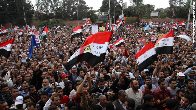 Morsy supporters gather outside the presidential palace in Cairo on Friday. Morsy insisted that Egypt was on the path to &quot;freedom and democracy,&quot; as protesters held rival rallies over sweeping powers he assumed that further polarized the country's political forces.