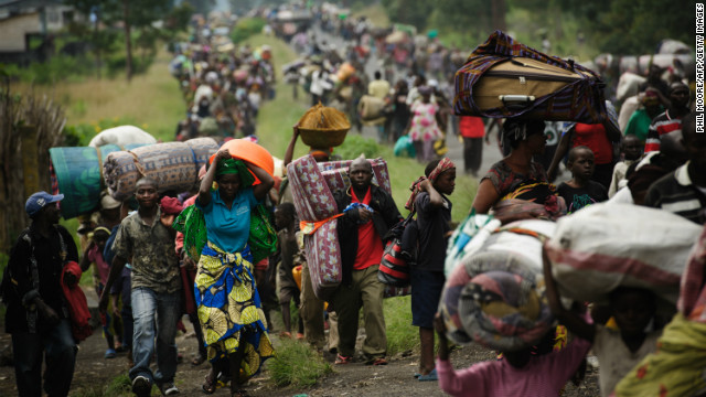 The violence drove tens of thousands of Congolese from their homes. Here on November 22 2012, thousands fled the town of Sake and headed east to the camps for displaced in the village of Mugunga.