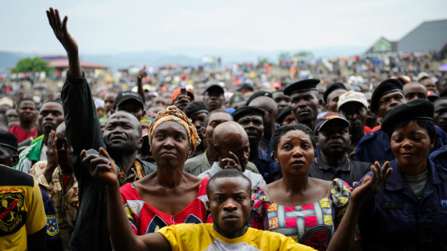 Residents of Goma listen to M23 rebel group spokesman at the Volcanoes Stadium in Goma on November 21, 2012.
