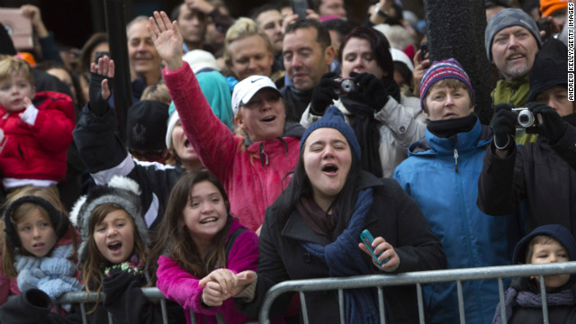 People along Sixth Avenue cheer during the Macy's Thanksgiving Day Parade. This year Macy's donated tickets and transportation to the parade to 5,000 people from neighborhoods hardest hit by Superstorm Sandy.