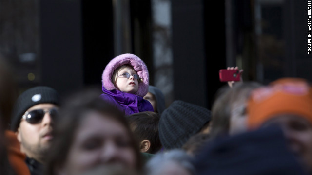 People watch as the parade makes its way down the streets of New York.