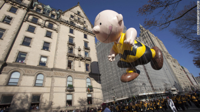 The Charlie Brown balloon is carried along the parade route.