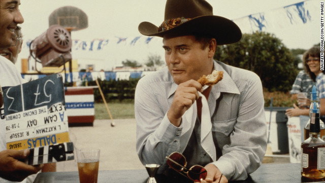 Larry Hagman eats on the set of the television soap opera &quot;Dallas&quot; in July 1979.