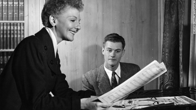Hagman was the son of actress and singer Mary Martin. Here, they rehearse a song. 