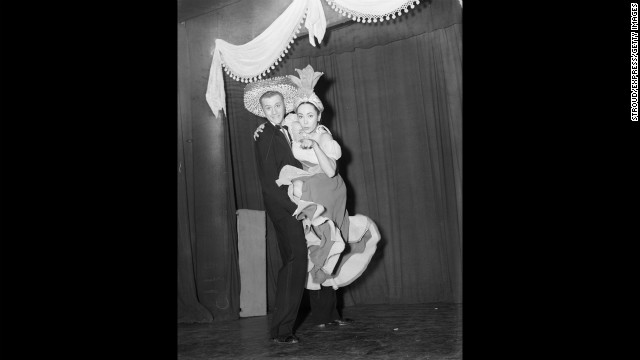 Hagman and actress Betta St. John wear exotic costumes during a stage show in 1952.