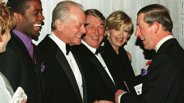 Britain's Prince Charles shares a light moment with actors Adrian Lester, left, Larry Hagman and Mike Nichols and journalist Diane Sawyer when the prince met the cast of the film &quot;Primary Colors&quot; on October 29, 1998.