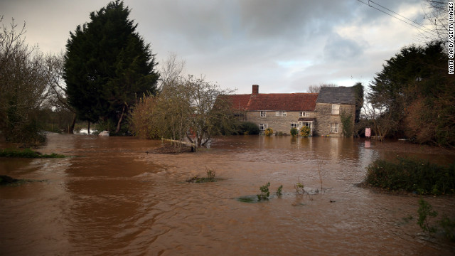 England flooding kills 1, more rain on way