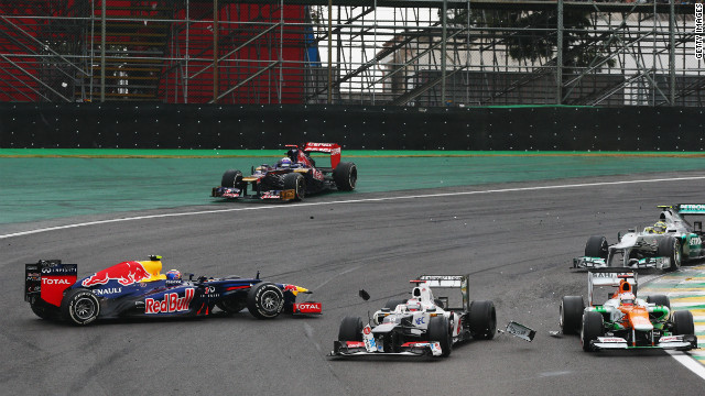 On Sunday, Vettel fought off feisty toreador Fernando Alonso to capture the drivers' title in a dizzying denouement and join an elite band of Formula One world champions.