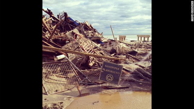 The pylons in the background of this shot of a damaged playground in Rockaway once supported a boardwalk.