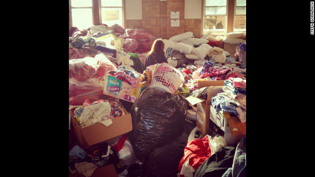 A volunteer helps sort clothing donations at St. Francis de Sales Catholic Church in the Rockaway neighborhood.