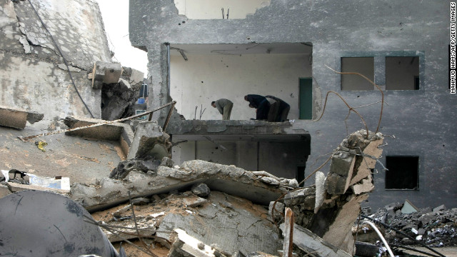 Employees of the Palestinian Interior Ministry pray in the rubble of the Interior Ministry building in Gaza City on Sunday, November 25.