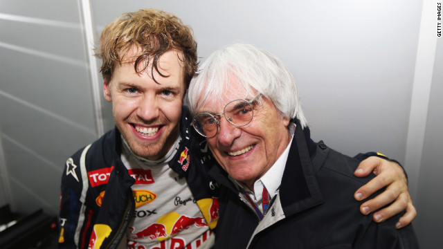 Vettel celebrates with Formula One supremo Bernie Ecclestone following his title win in Brazil.